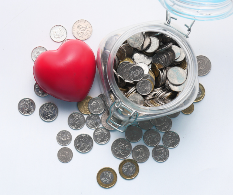 tax credit donations represented by a jar full of coins and a red heart